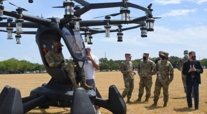 Riding a drone. The Pentagon is testing a flying taxi