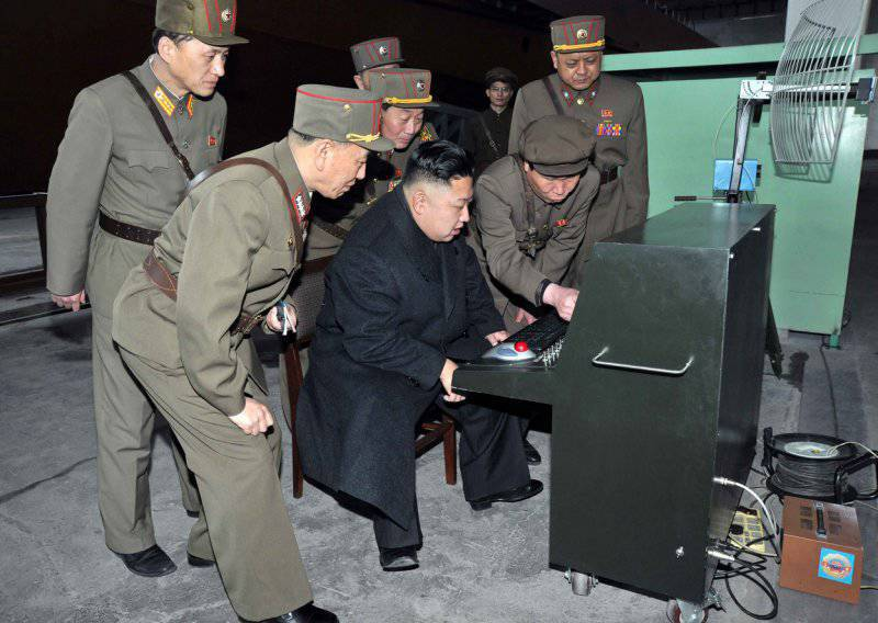 North Korean leader Kim Jong-un looks at the latest developed combat and technical equipment assembled at the 1501 facility by the Korean People's Army, 24 March 2013