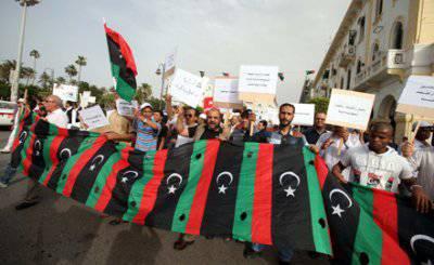 Полтора года без Каддафи, или В чём схожесть новой Ливии и России образца начала 90—х?