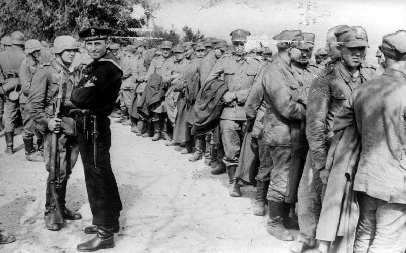 German sailor and soldiers at the column of Polish prisoners in the vicinity of Danzig (Gdansk).