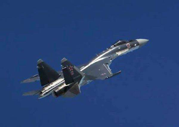 Su-35S within the framework of the flight tactical exercises covered aircraft of the anti-submarine aviation of the Pacific Fleet in the area of the Kuril Islands