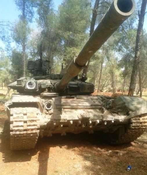 Militanlar, Suriye ordusu tarafından ağa atıldığı iddia edilen bir T-90A'nın fotoğrafını yayınladı