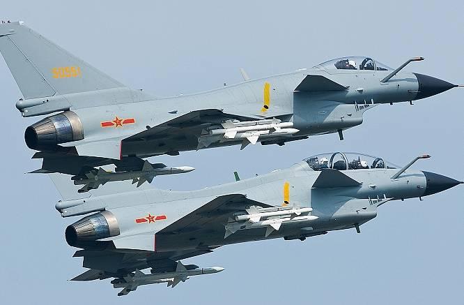 Reuters истребители КНР заставили изменить курс самолет ВМС США над Восточно Китайским морем