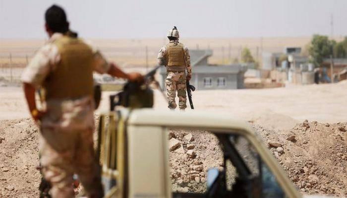 伊拉克部队正在等待命令被派往与库尔德人有争议的地区