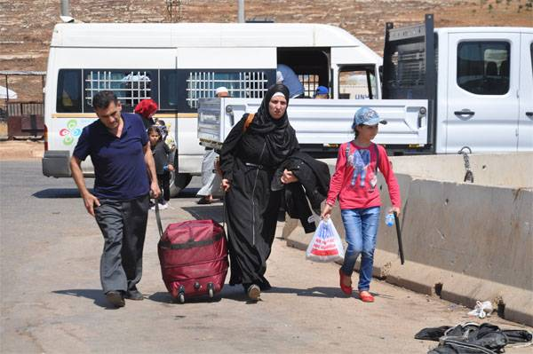 Refugees return to Syria