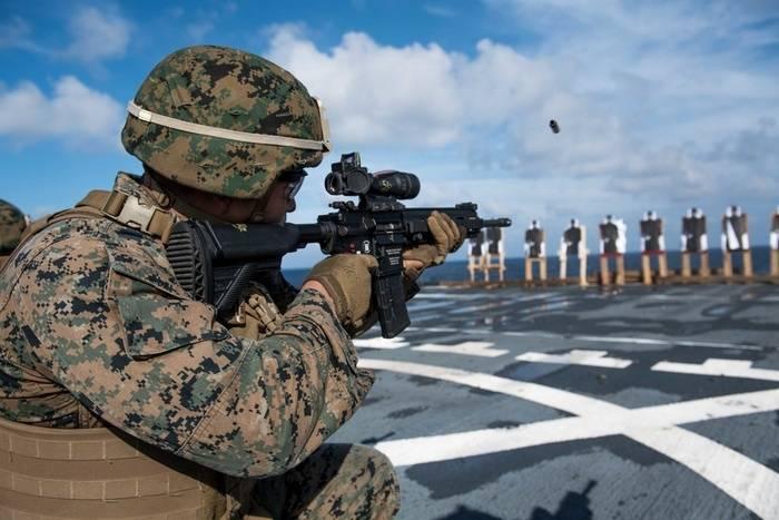 US marines armed with German machine guns