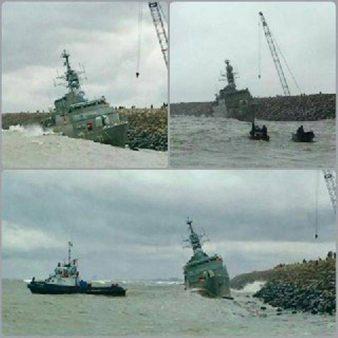 Iranian frigate thrown on a breakwater during a storm