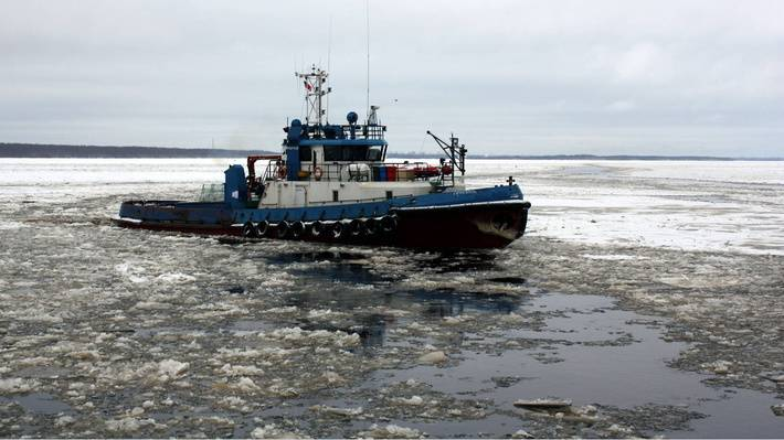 Tugs of the Pacific Fleet clear ice from fairways in bays where warships are based