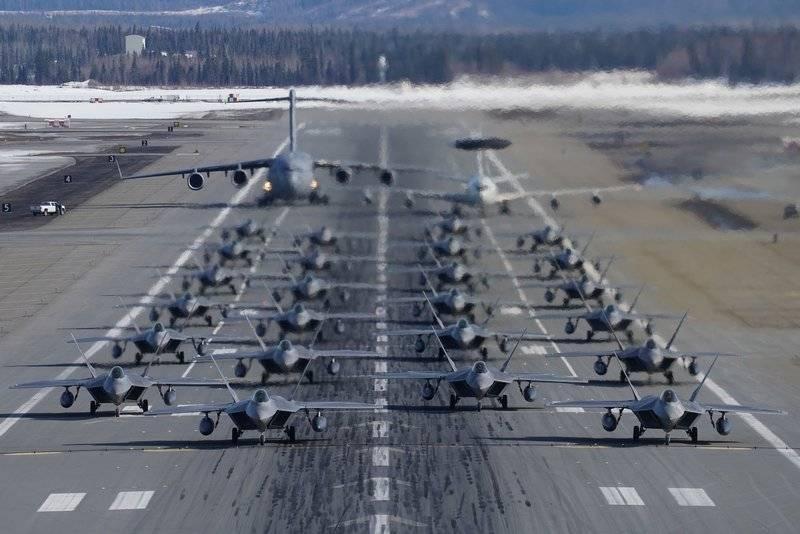 American F-22 fighter jets work off Elephant Walk in Alaska