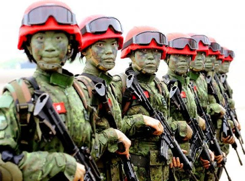 """Masking on-Taiwan: Camouflage """"figure"""" and red helmets"""