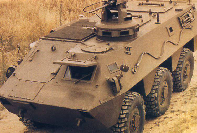 Spanish look at a wheeled armored personnel carrier. BTR BMR-600