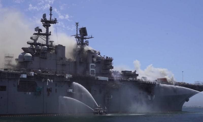Part of the take-off deck collapses on the burning American UDK Bonhomme Richard