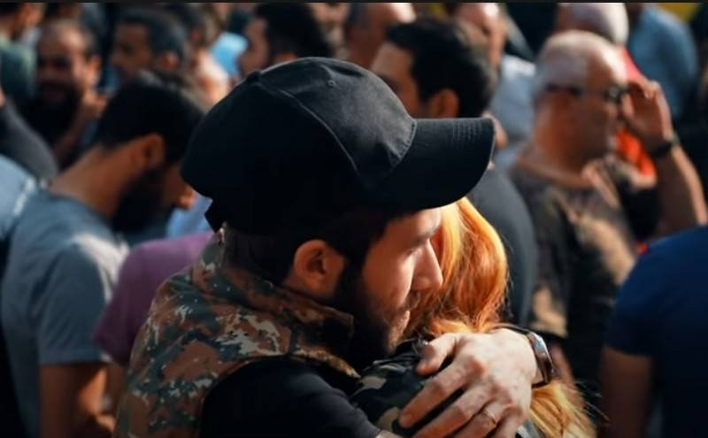 """""""Armenians return home and sign up as volunteers"""" - Armenian side"""